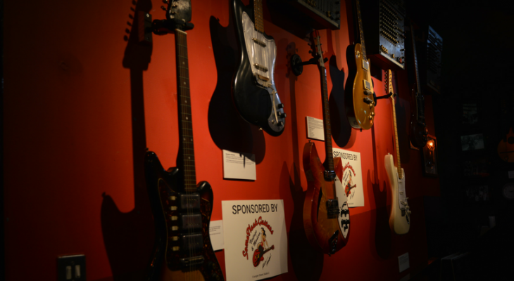 Background-picture-in-RockNRoll-museum-Guitars-on-the-wall1